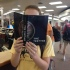Students visit the library to take part in the book sharing program for The Testing.