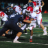 Senior Jowan Edmond tackled by Addison player at last Friday's game.