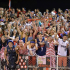 The Hinsdale Central student section shows its pride on America day at Dickinson Field during the Sept. 26 game against Glenbard West.