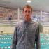 Coach Daniel Otahal stands poolside.