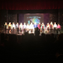 The cast of the freshmen play stand during applause.