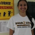 Ramasastry proudly poses near the hallway that Invite to Teach students spend most of their time.