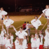 The varsity cheerleading squad executes a formation at the pink out football game against Oak Park.