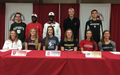 Seniors sign and commit to collegiate athletics
