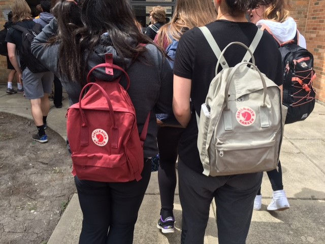 Devils' Advocate writers Sanya Sawlani (left) and Libby McCarthy (right) used their Fjällräven backpacks on the day of the in-school ACT test when they didn't have to carry as many supplies as normal