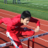 Shawn Zhou, junior, trains for hurdles during track and field practices after school.