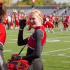Cothard waves to the camera before a color guard performance during the fall season.