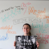 Julia Guglielmo, senior, poses under the song titles from Rixton's debut album, Let the Road.