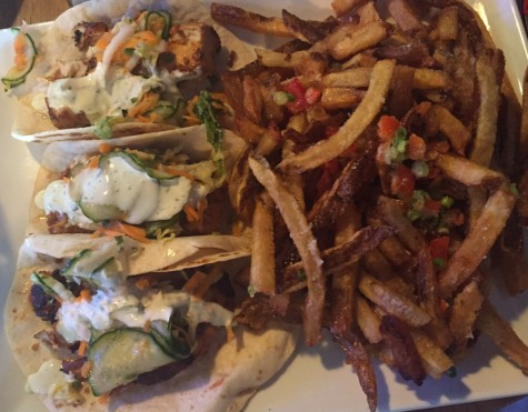 The fish tacos accompanied with truffle fries are unique and filling