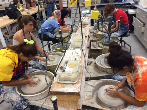 Students in Ceramics race to finish their Homecoming art pieces.
