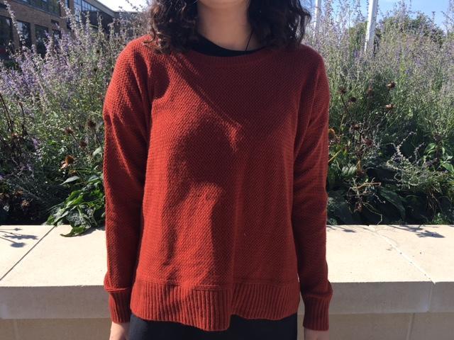 Libby Mccarthy models a burnt orange sweater