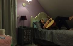 Strings of her guitar