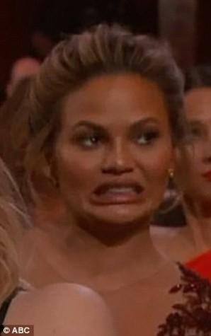 Chrissy Teigen cringing at Chris Rock's opening monologue.