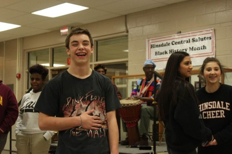 Alex Roca, sophomore, stopped by to dance and take part in the African performances.