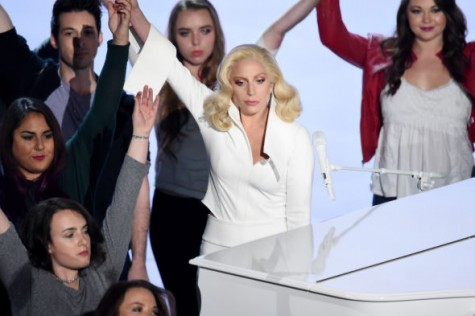Lady Gaga standing with victims of sexual assault after a tearjerking performance.