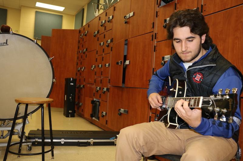 During AP Music Theory, Sammy Dussias relaxes in the corner and practices his craft.
