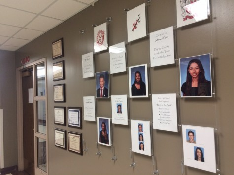Where the wall stood proud, we now see modest acknowledgements of students.