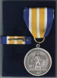 Picture of the medal that comes with the award given to those honored by it.