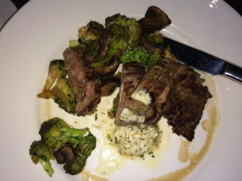 Dry Aged Steak with roasted broccoli, marinated mushrooms, and béarnaise sauce.
