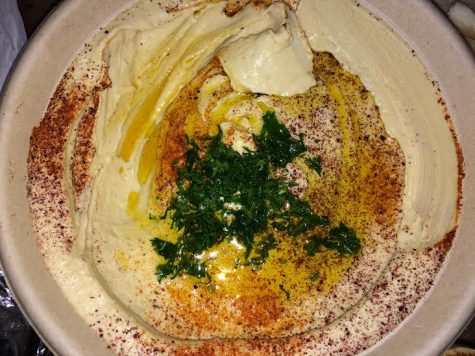 Hummus with olive oil, chopped parsley, and spices.