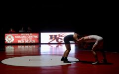Boys wrestling defeats rival Hinsdale South