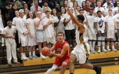 Boys basketball team takes on District 86 rival