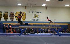 Girls gymnastics defeats rival Lyons Township