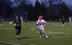 Boys varsity lacrosse team wins home opener