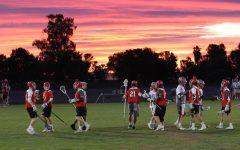 Boys varsity lacrosse team prepares to face LT